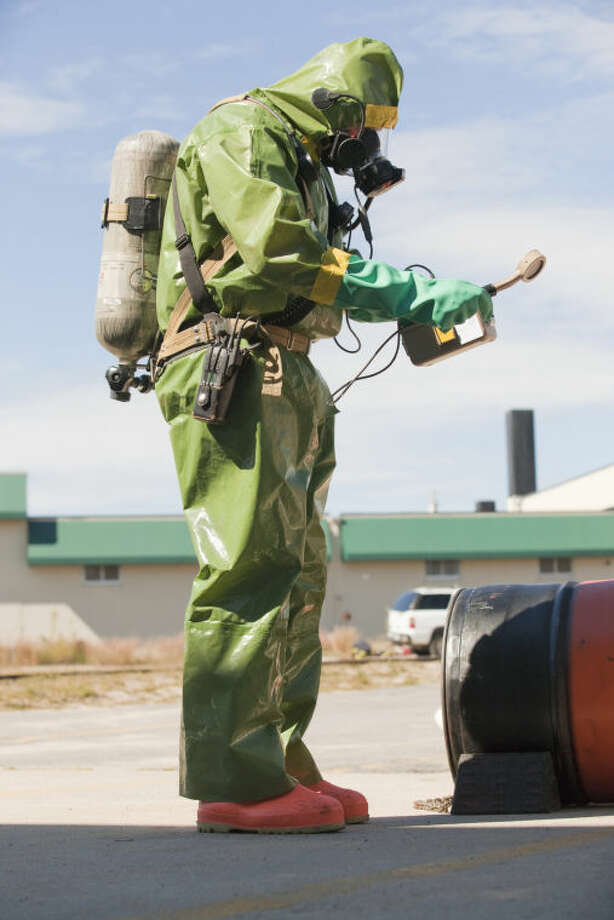 HazMat firefighter taking radiation reading Photo: Photo Illustration