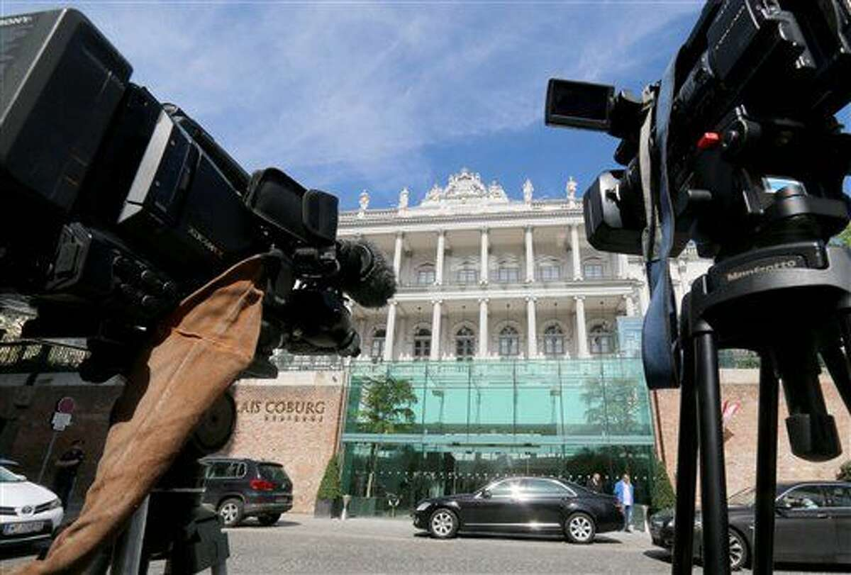 Cameras stand in front of a luxury downtown hotel, where closed-door nuclear talks with Iran take place, in Vienna, Austria, Wednesday, April 22, 2015. Negotiators are meeting in attempts to reach a deal that curbs Iran's nuclear program in exchange for sanctions relief. (AP Photo/Ronald Zak)