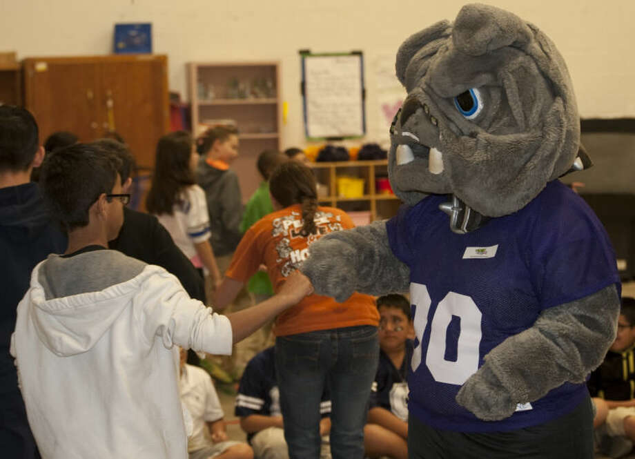 Midland High mascot Spike greets students as they enter the gym during the Fuel Up to Play 60 pep rally Tuesday morning at Fannin Elemenatry. Tim Fischer\Reporter-Telegram Photo: Tim Fischer