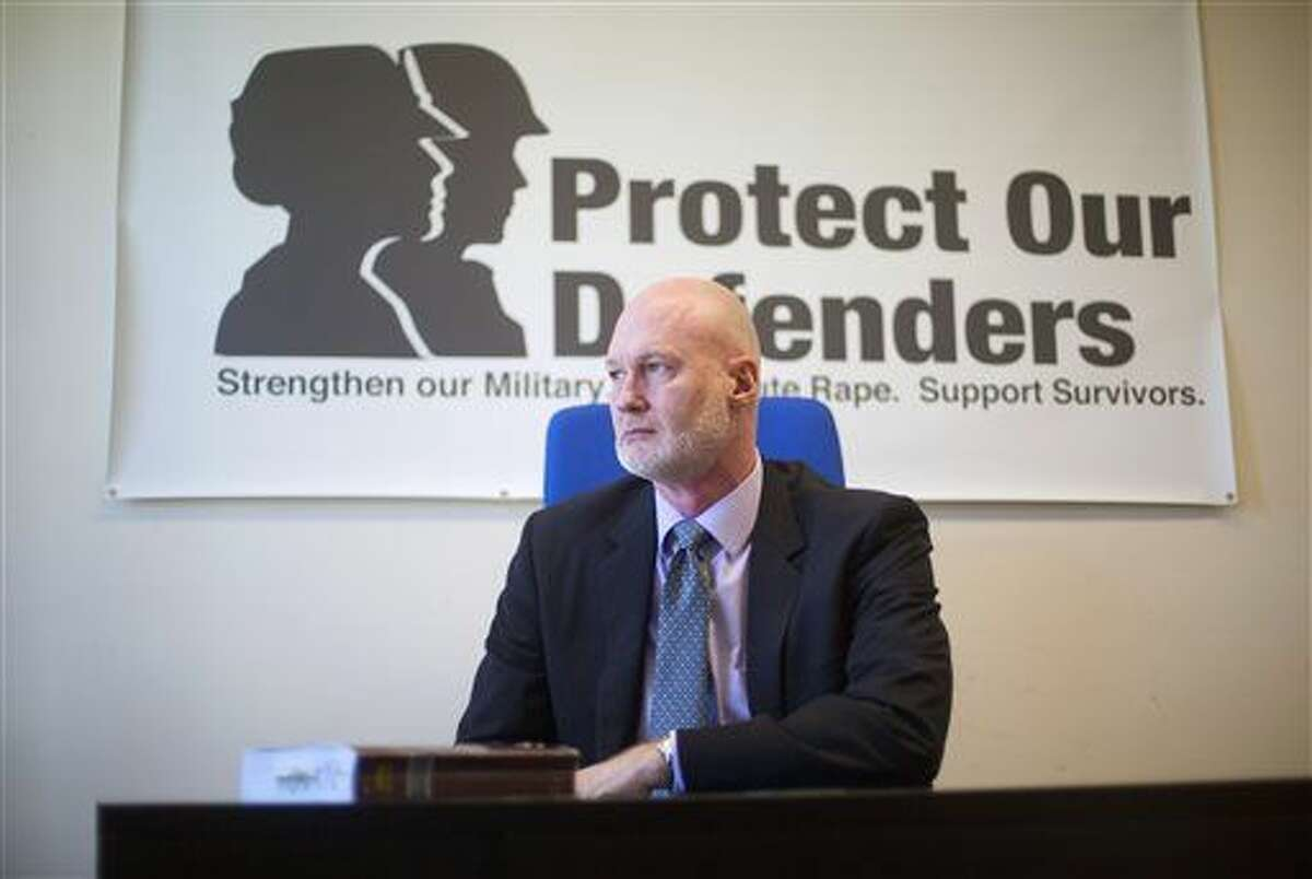 In this photo taken April 15, 2016, Retired Air Force Col. Don Christensen is seen in his office at Protect Our Defenders (POD), a national organization solely dedicated to addressing the epidemic of rape and sexual assault in the military, in Washington. The Pentagon misled Congress with inaccurate information about sexual assault cases that portrayed civilian law enforcement officials as less willing than military commanders to investigate and punish sex offenders, an Associated Press investigation found. (AP Photo/Pablo Martinez Monsivais)