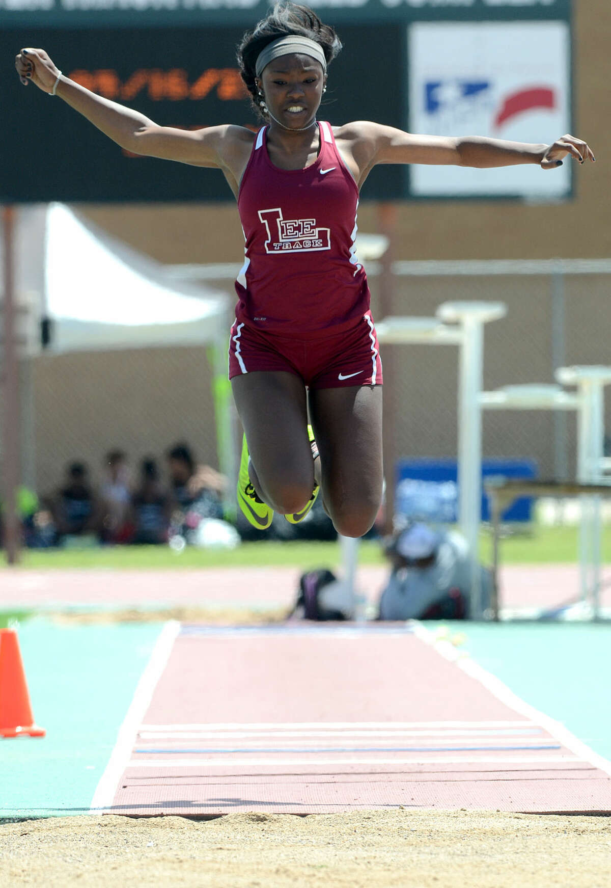 Bri'An Washington competes in the triple jump during the District 3-6A Track and Field Championships on Thursday, April 16, 2015, at Memorial Stadium James Durbin/Reporter-Telegram