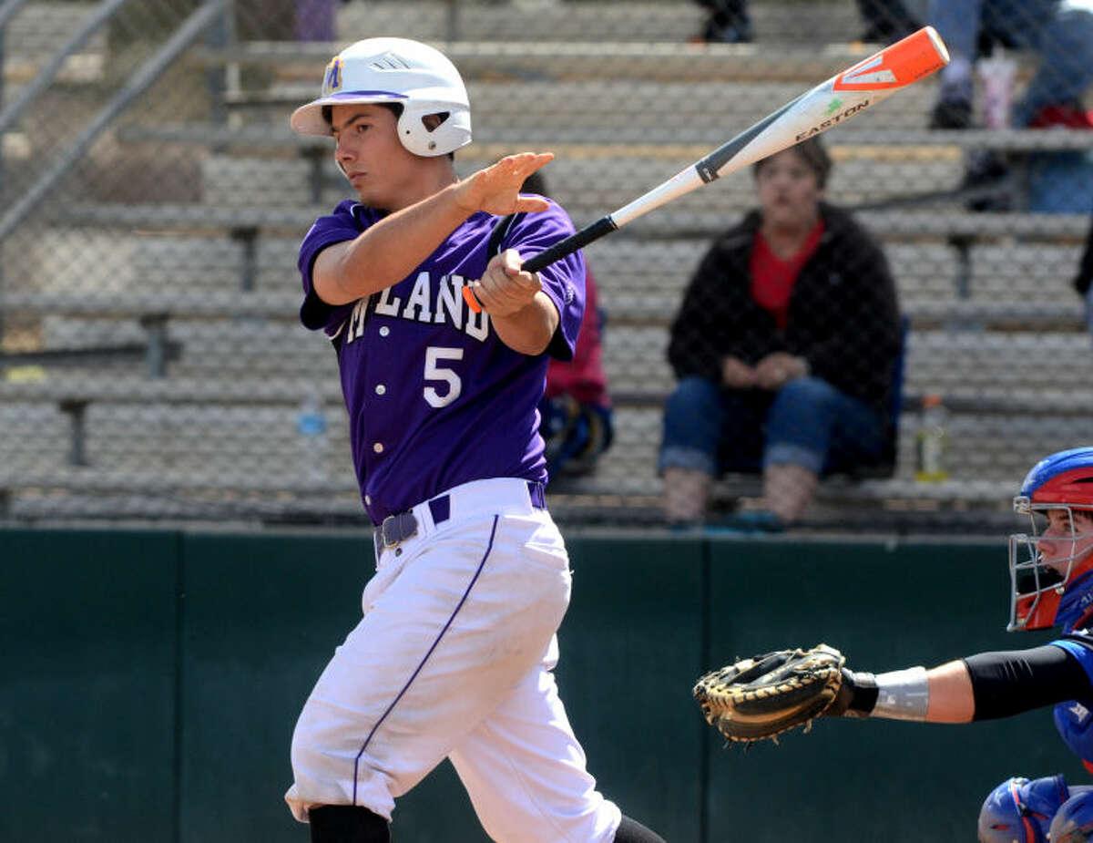 Midland High's Lance White hits against Abilene Cooper on Saturday at Zachery Field. James Durbin/Reporter-Telegram