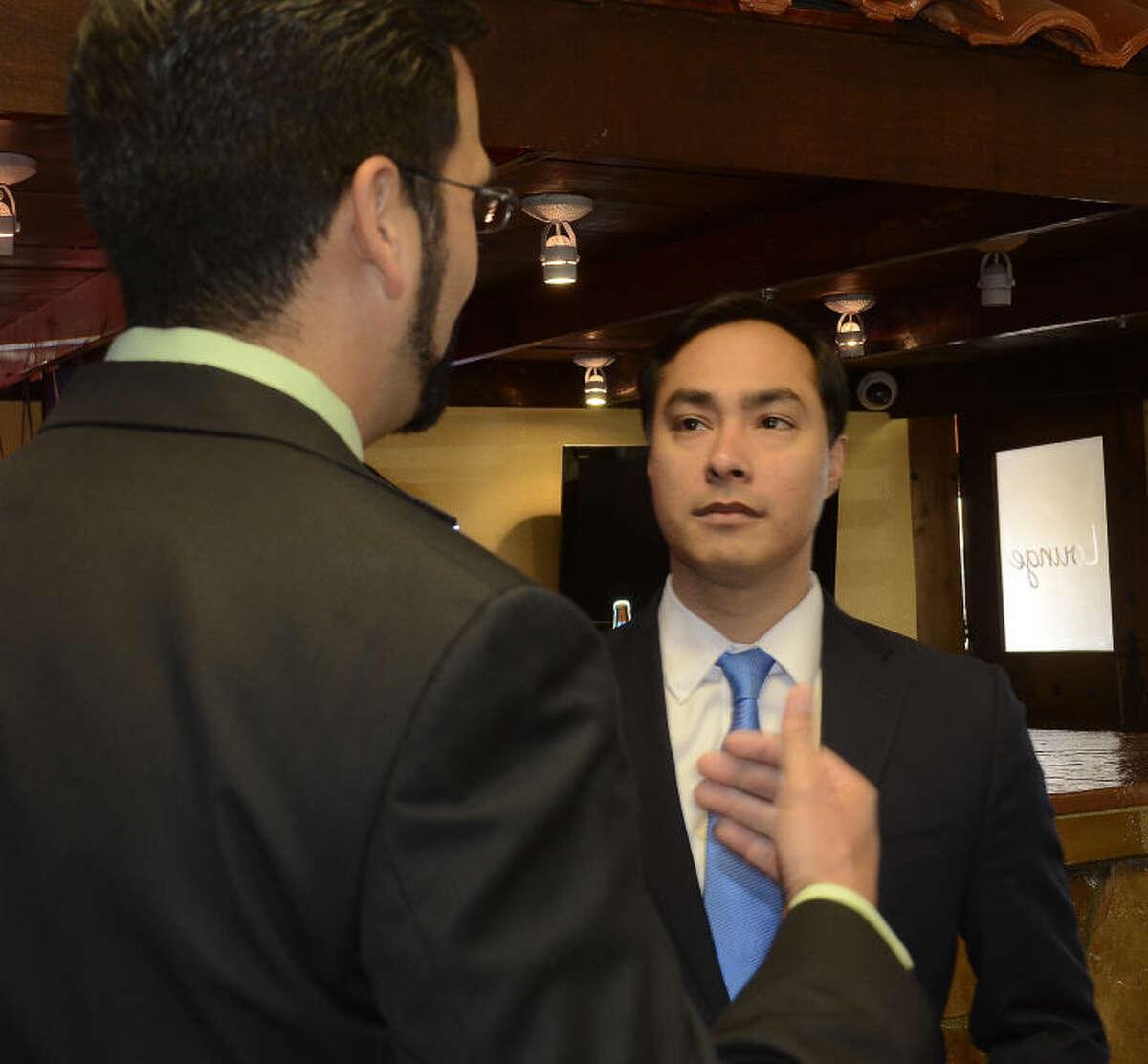 Congressman Joaquin Castro talks with Midland County Commissioner Luis Sanchez Wednesday morning at a fundraiser at Martinez Bakery. Tim Fischer\Reporter-Telegram