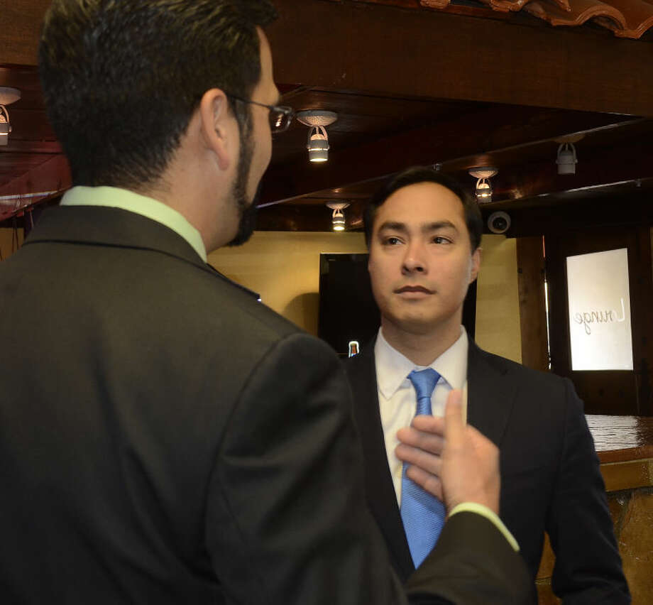 Congressman Joaquin Castro talks with Midland County Commissioner Luis Sanchez Wednesday morning at a fundraiser at Martinez Bakery. Tim Fischer\Reporter-Telegram Photo: Tim Fischer