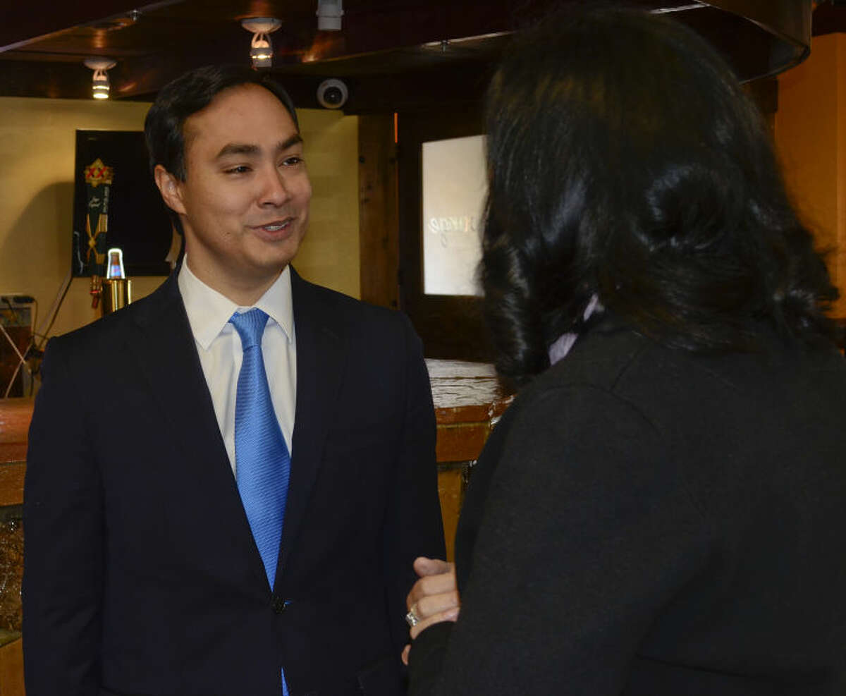 Congressman Joaquin Castro talks with Mary Gonzales Wednesday morning at a fundraiser at Martinez Bakery. Tim Fischer\Reporter-Telegram