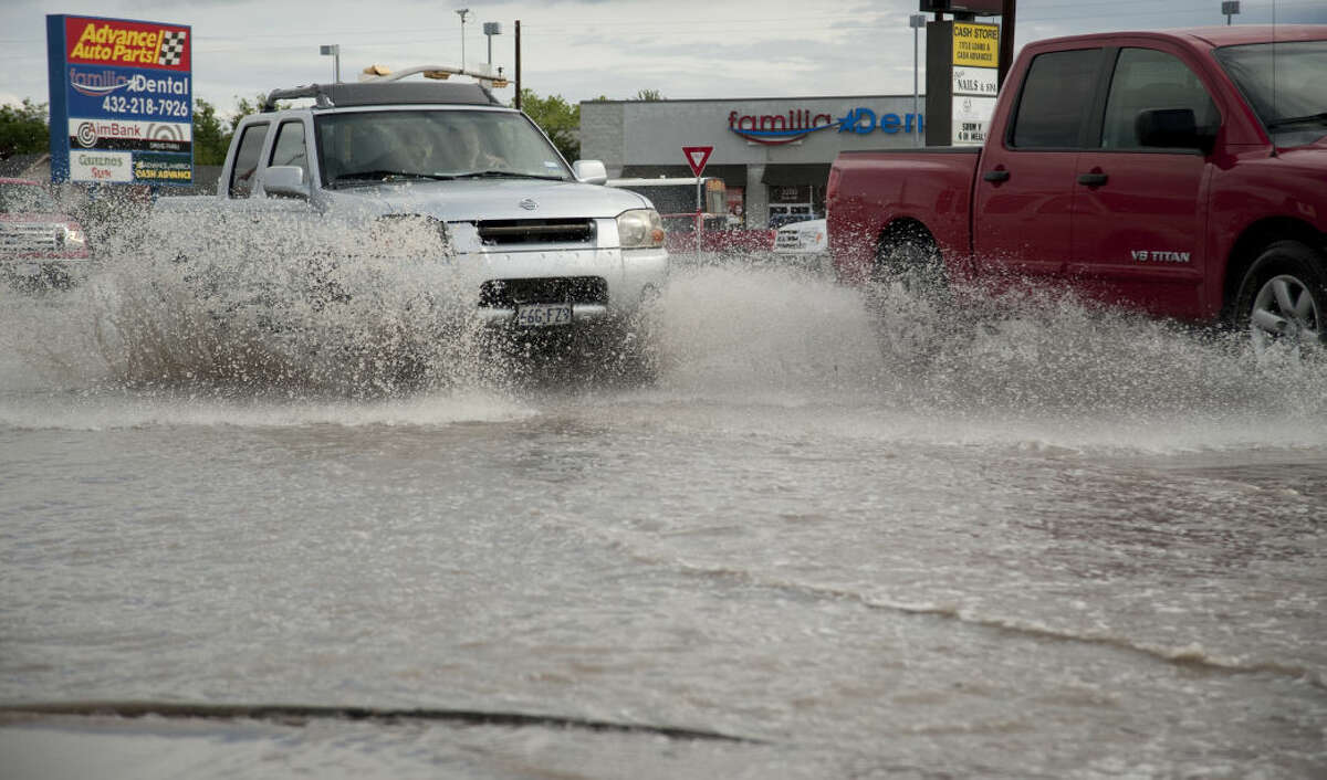 Morning rains flooded some streets and intersections Friday, 4-24-15, like Andrews Hwy and Midkiff pictured here. Tim Fischer\Reporter-Telegram