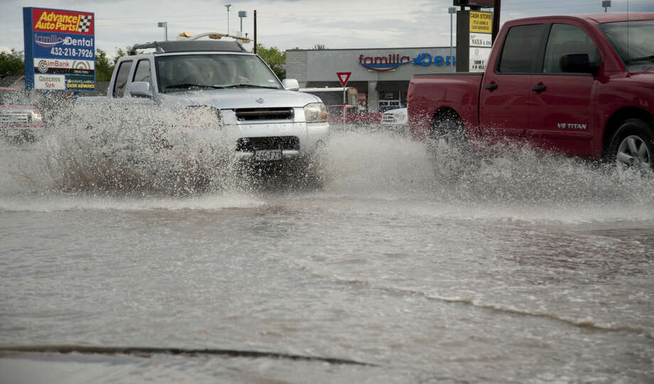 Morning rains flooded some streets and intersections Friday, 4-24-15, like Andrews Hwy and Midkiff pictured here. Tim Fischer\Reporter-Telegram Photo: Tim Fischer
