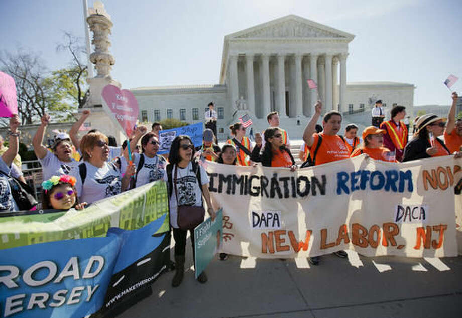 Supporters of fair immigration reform gather in front of the Supreme Court in Washington, Monday, April 18, 2016. The Supreme Court is taking up an important dispute over immigration that could affect millions of people who are living in the country illegally. The Obama administration is asking the justices in arguments today to allow it to put in place two programs that could shield roughly 4 million people from deportation and make them eligible to work in the United States. (AP Photo/Pablo Martinez Monsivais) Photo: Pablo Martinez Monsivais