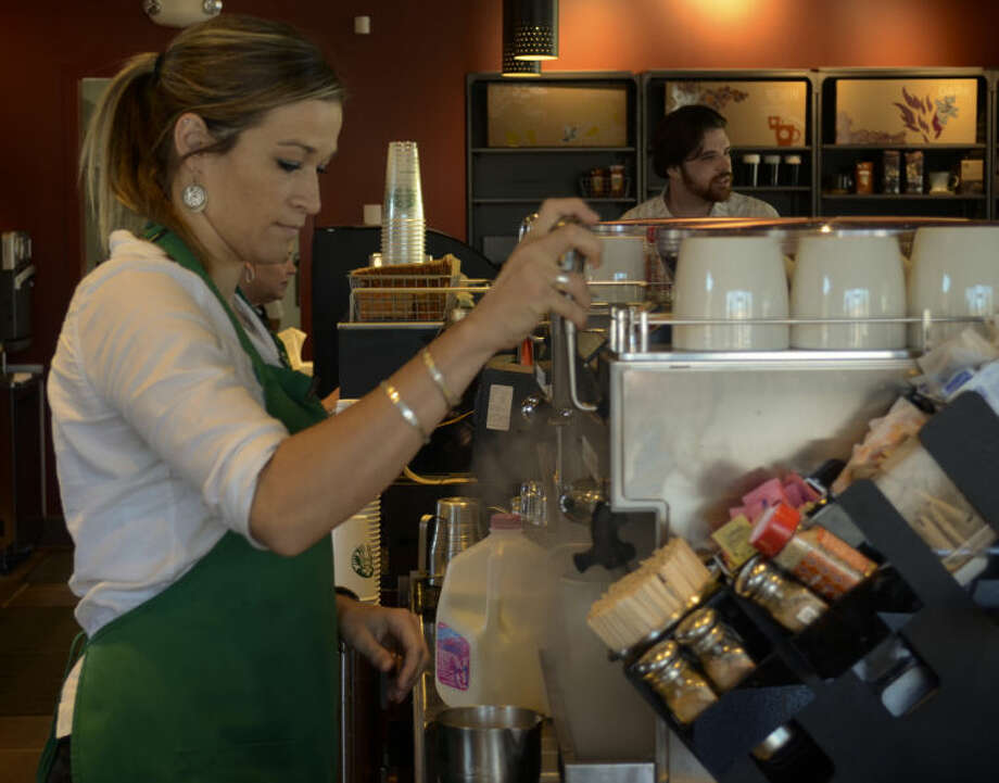 (File Photo) Starbucks barista prepares a drink in the Starbucks at the Cornerstone Shopping Center. Tim Fischer\Reporter-Telegram Photo: Tim Fischer