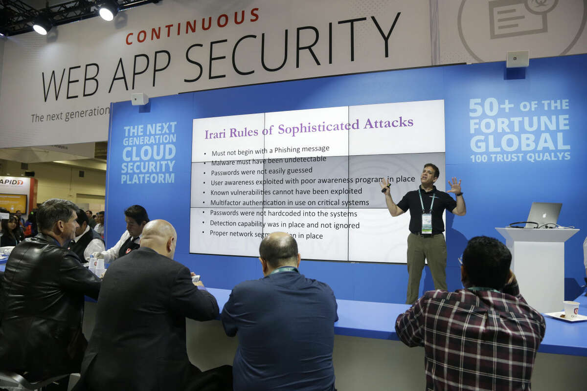 A presentation on web app security is made during the RSA Conference on Wednesday, April 22, 2015, in San Francisco. Threat analysts, security vendors and corporate IT administrators have gathered here to talk about malicious software, spear-phishing and other attacks that can steal money or secrets from companies and consumers. (AP Photo/Marcio Jose Sanchez)