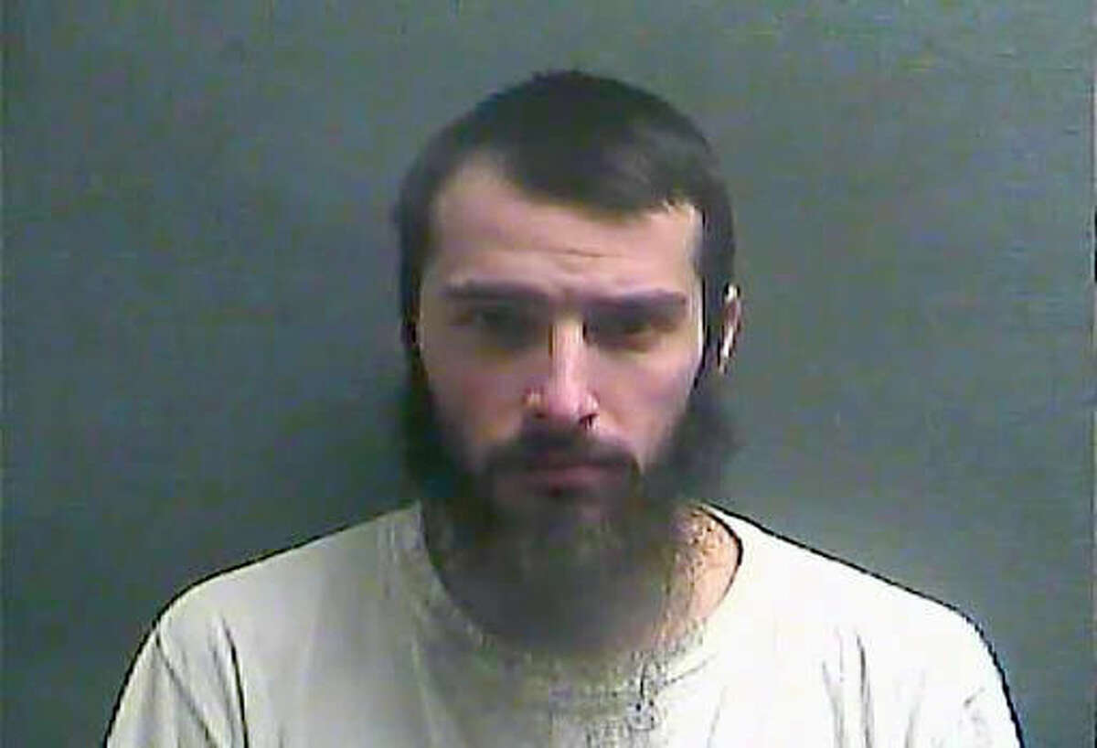 FILE - This Jan. 14, 2016, booking file photo made available by the Boone County Jail in Burlington, Ky., shows Christopher Lee Cornell on the anniversary of his arrest by FBI agents who said he bought weapons for an attack on the U.S. Capitol. Cornell, a suburban Cincinnati man, the beard and long hair he had when arrested gone, has been calling himself again by his birth name and appears competent to stand trial on charges that he plotted to attack the U.S. Capitol in support of the Islamic State group, according to testimony Monday, April 18, 2016. (Boone County Jail via AP, File)