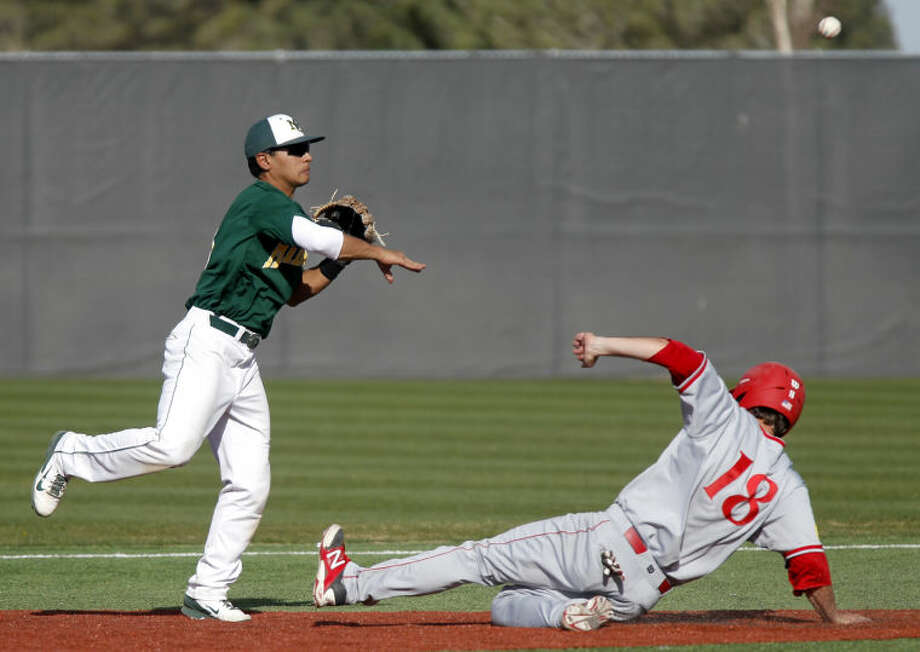 Midland College's Josh Narvaiz makes a throw for a double play over New Mexico Junior College's Preston Marsh on Friday at Christensen Stadium. James Durbin/Reporter-Telegram Photo: JAMES DURBIN