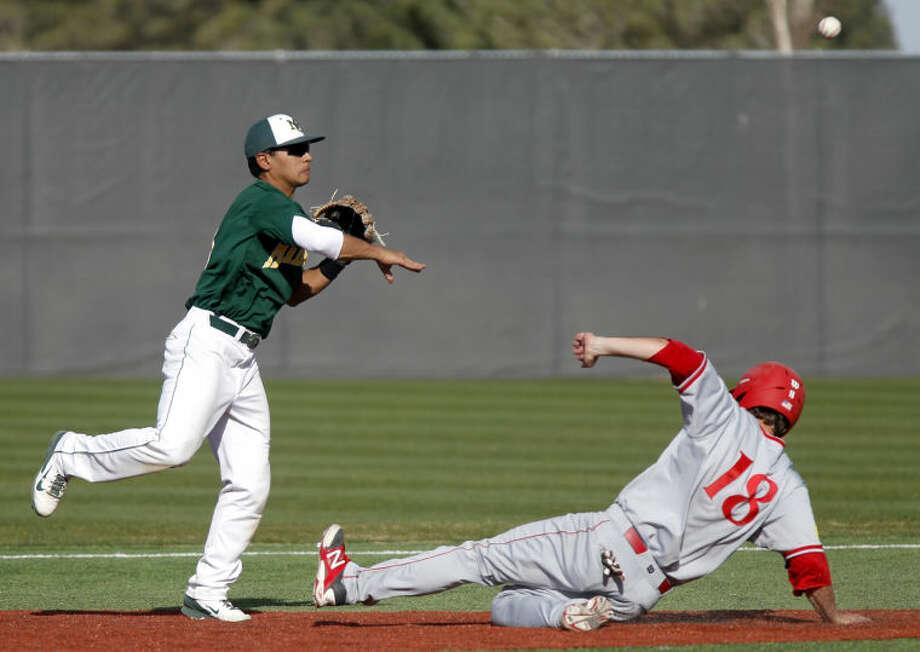 Midland College's Josh Narvaiz makes a throw for a double play over New Mexico Junior College's Preston Marsh on Friday at Christensen Stadium. James Durbin/Reporter-Telegram Photo: JAMES DURBIN