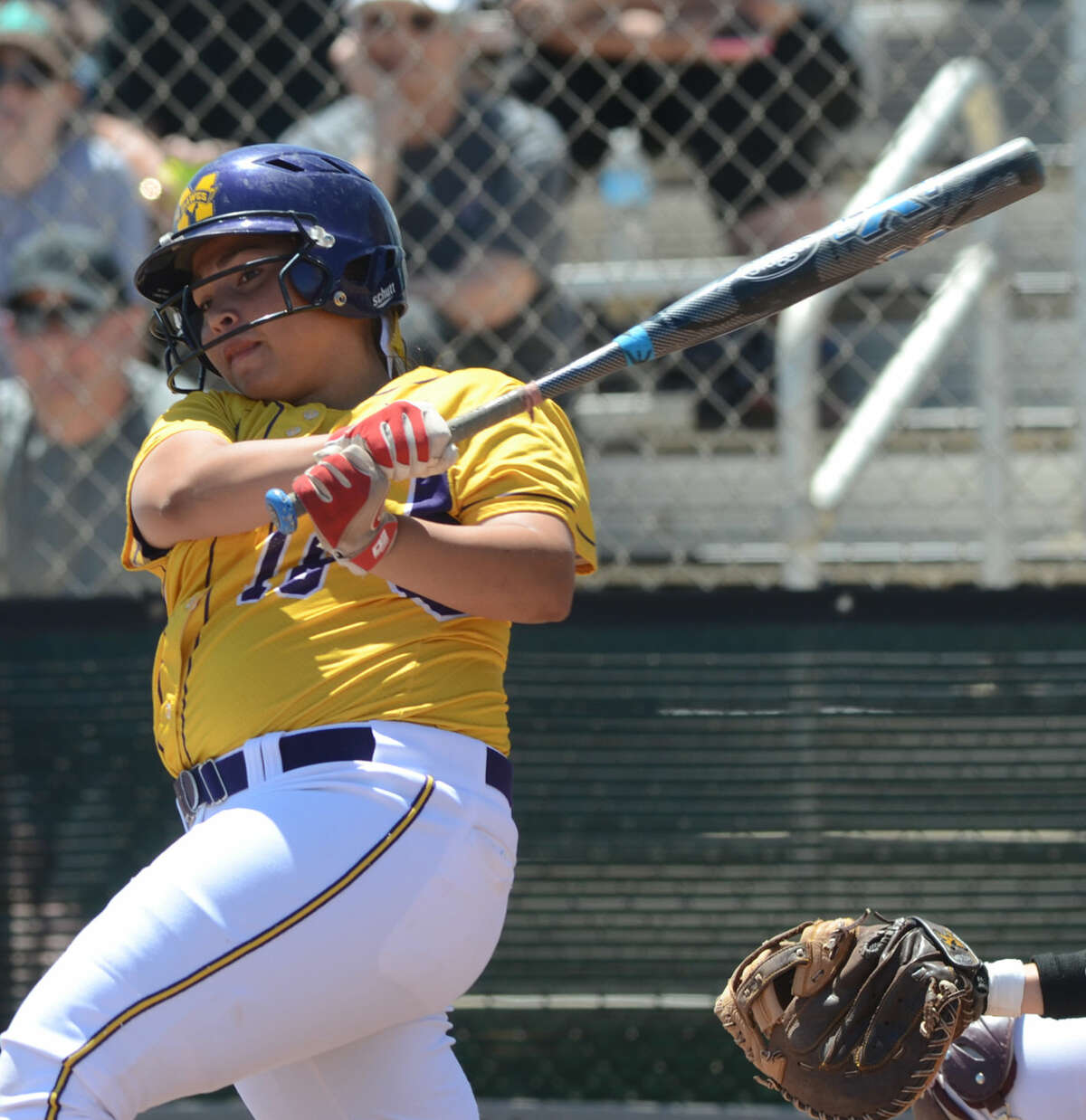 Midland High's Natalie Gamboa hits against Lee High on Saturday, April 25, 2015, at Audrey Gill Sports Complex. James Durbin/Reporter-Telegram