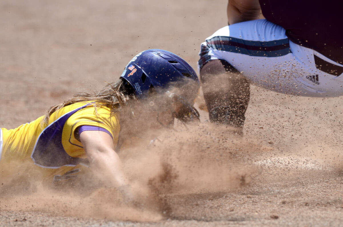 Midland High's Taylor Conner slides into third base against Lee High on Saturday, April 25, 2015, at Audrey Gill Sports Complex. James Durbin/Reporter-Telegram
