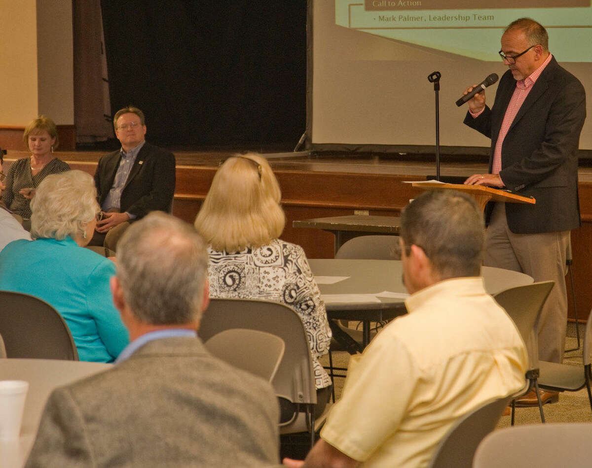 Educate Midland board member Mark Palmer speaks at a town hall meeting Thursday at First Presbyterian Church.
