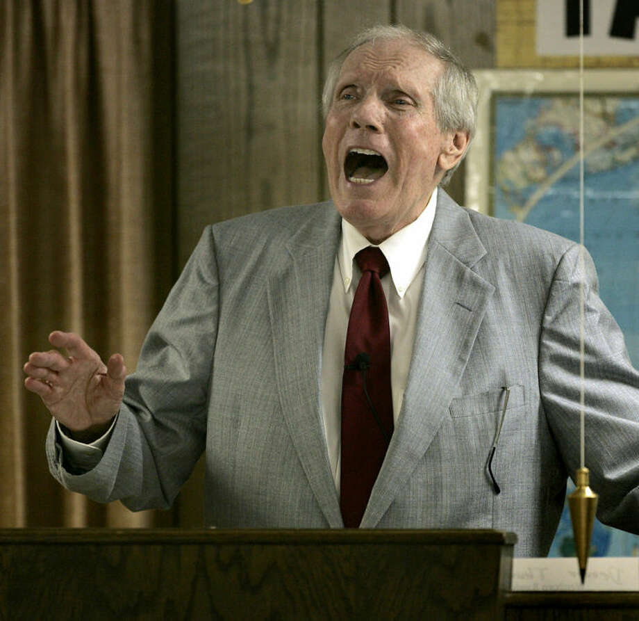 FILE - In this March 19, 2006 file photo, Rev. Fred Phelps Sr. preaches at his Westboro Baptist Church in Topeka, Kansas. Phelps, who founded a Kansas church that's widely known for its protests at military funerals and anti-gay sentiments, is being cared for in a Shawnee County facility according to Westboro Baptist Church spokesman Steve Drain on Sunday, March 16, 2014. (AP Photo/Charlie Riedel, File) Photo: Charlie Riedel