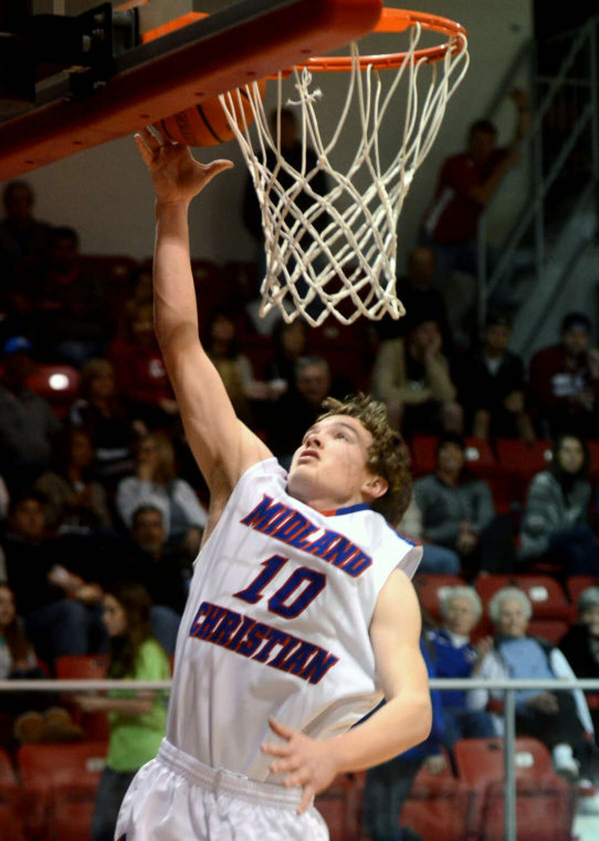 Midland Christian's Grant Little (10) makes a layup against Fort Worth Christian on Friday at McGraw Special Events Center. James Durbin/Reporter-Telegram