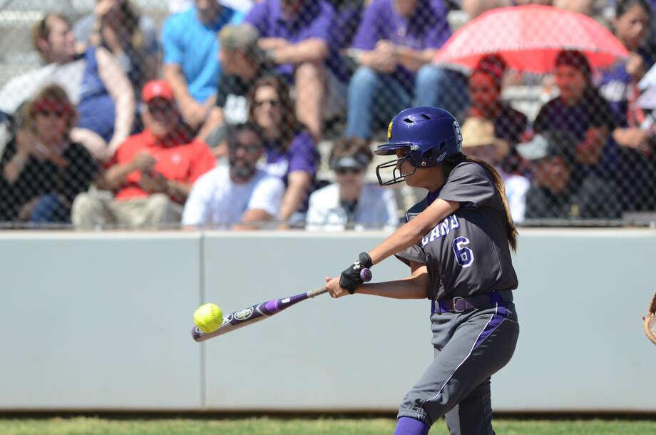 Midland High's Alyssa Flores hits against Lee High on Saturday, March 28, 2015. James Durbin/Reporter-Telegram