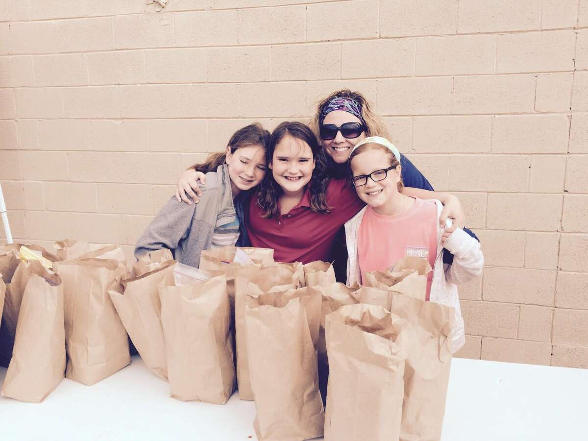 Elizabet Adamson and her fourth-grade advisory students handed out lunches at Church Under the Bridge Midland.