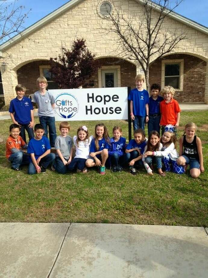 Second-graders in Ashley Pargmann's class visited Hope House, donated bags of needed items and then delivered Chemo Survival Bags to the patients who were receiving treatment at Allison Cancer Center.