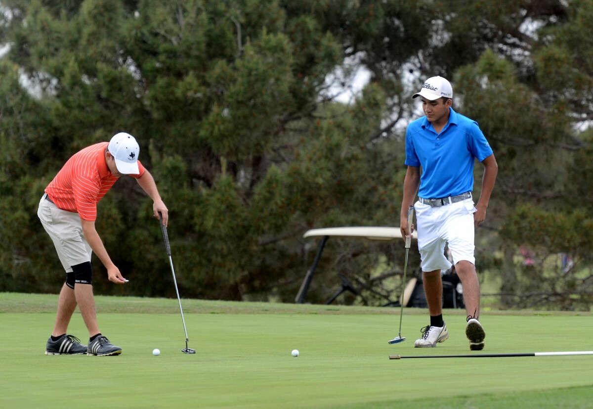 Andrews golfers Bracston Parker (left) and Ivan Armendariz (right) during practice Thursday, April 23, 2015, at Green Tree Country Club. James Durbin/Reporter-Telegram