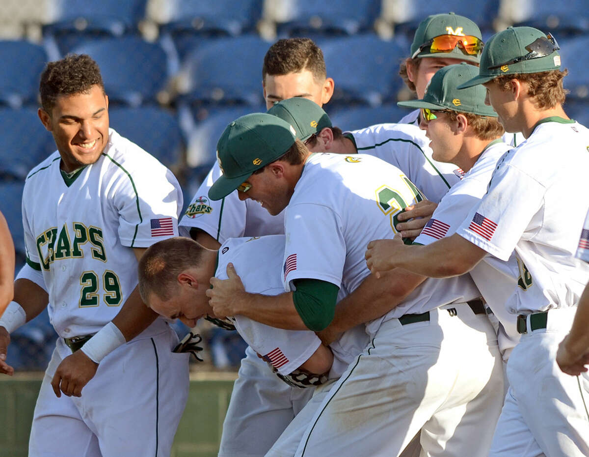 Midland College's Chris Thibideau is mobbed by teammates after hitting his second game-ending home run of the day against New Mexico Military Institute on Friday, April 24, 2015, at Christensen Stadium. James Durbin/Reporter-Telegram