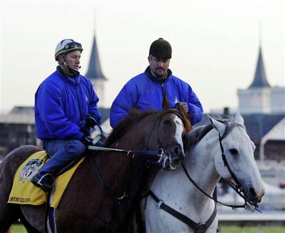 FILE - In this April 28, 2004, file photo, trainer Steve Asmussen, right, leads Kentucky Derby hopeful Quintons Gold Rush and exercise rider Scott Blasi off the track after a morning workout at Churchill Downs in Louisville, Ky. Thoroughbred racing regulators in New York and Kentucky are investigating allegations of mistreatment of horses by the Hall of Fame-nominated trainer and his top assistant. The states' racing commissions said Thursday, March 20, 2014, investigations were launched after People for the Ethical Treatment of Animals provided video evidence from an undercover investigation of Asmussen and associates. (AP Photo/Daniel P. Derella, File) Photo: Daniel P. Derella / AP