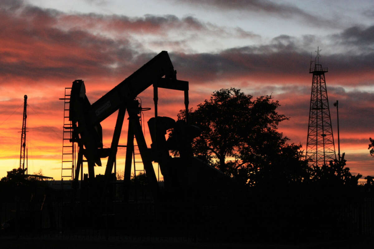The sun sets behind a pumpjack at the Petroleum Museum.