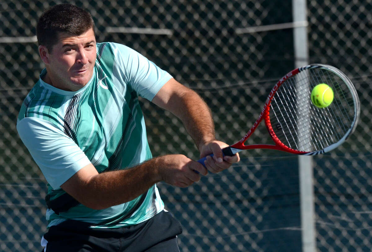 Jesse Witten hits during a doubles match Friday, April, 24, 2015, at the Racquet Cub in Midland. James Durbin/Reporter-Telegram