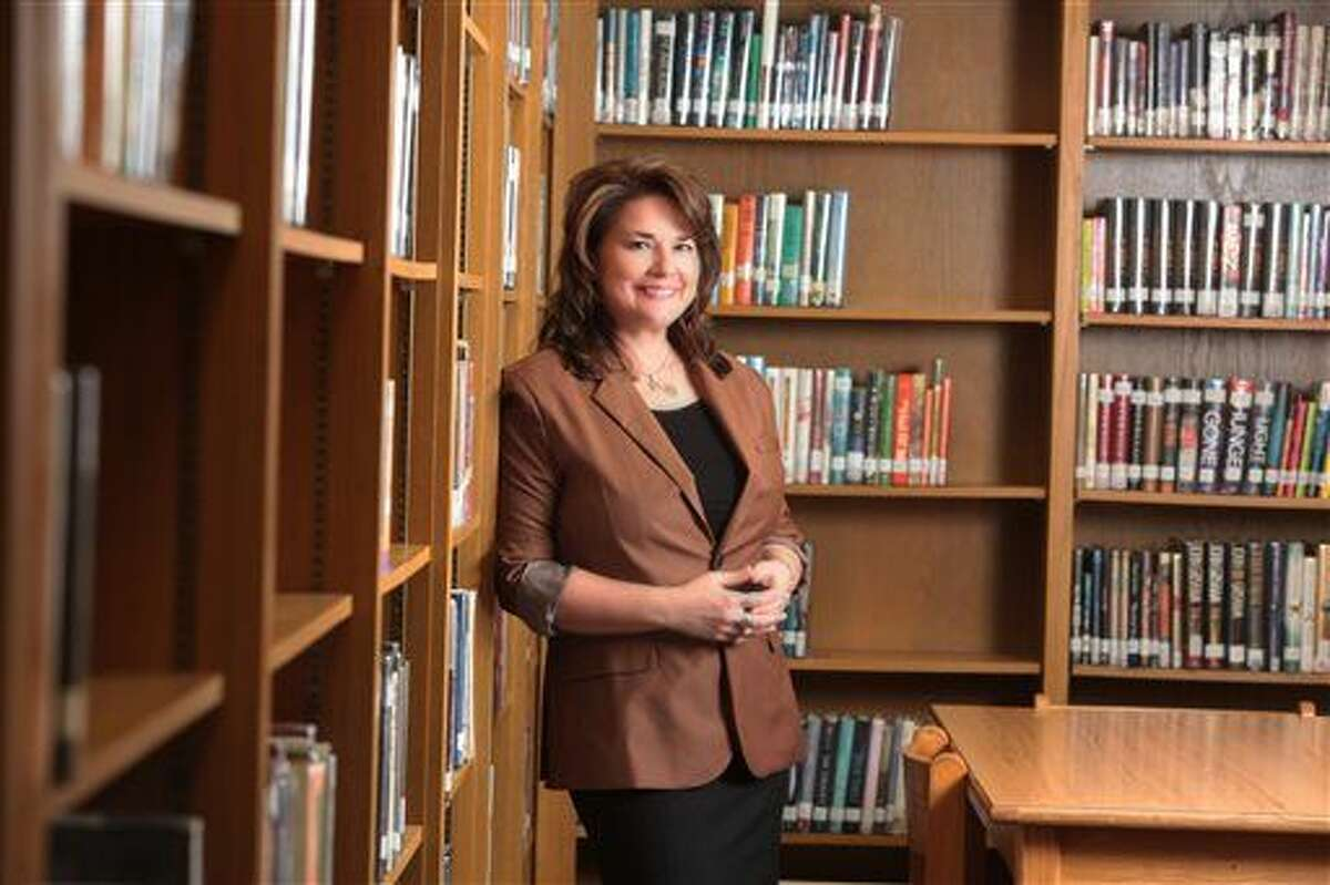 In this Jan. 29, 2015 photo provided by the Amarillo (Texas) Independent School District, Palo Duro High School English teacher Shanna Peeples poses for a photo. Peeples has been named 2015 National Teacher of the Year by the Council of Chief State School Officers. (Davy Knapp/Amarillo ISD via AP)