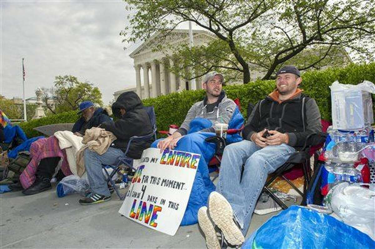 Sean Varsho, 28, of Chicago, left, and Brandon Dawson, 26, of Warrenton Va., have been waiting in line for the past three days for a seat for Tuesday's Supreme Court hearing on gay marriage, Monday, April 27, 2015, in Washington. The opponents of same-sex marriage are urging the court to resist embracing what they see as a radical change in society's view of what constitutes marriage. (AP Photo/Cliff Owen)