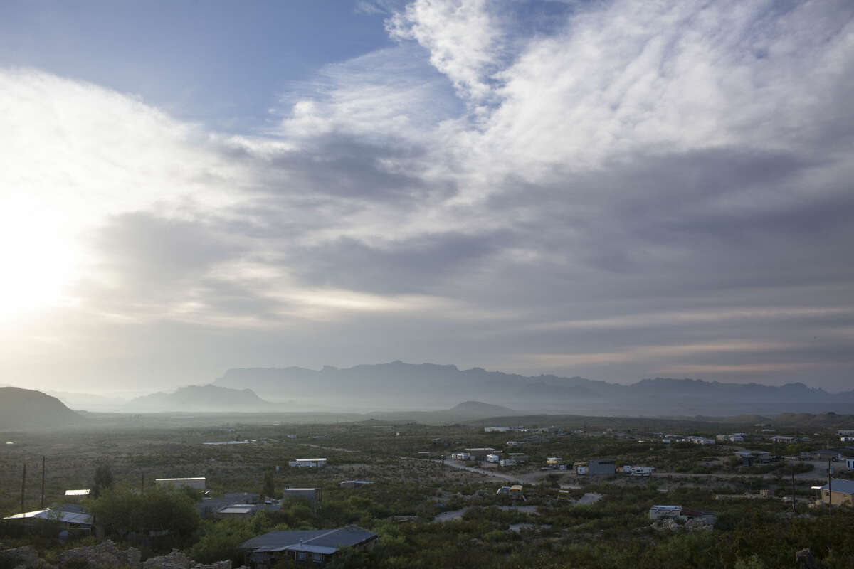 Terlingua, TX as seen from the top of a hill overlooking the town shortly after dawn on April 22, 2015. The Chisos mountains of Big Bend National Park stand in the distance.