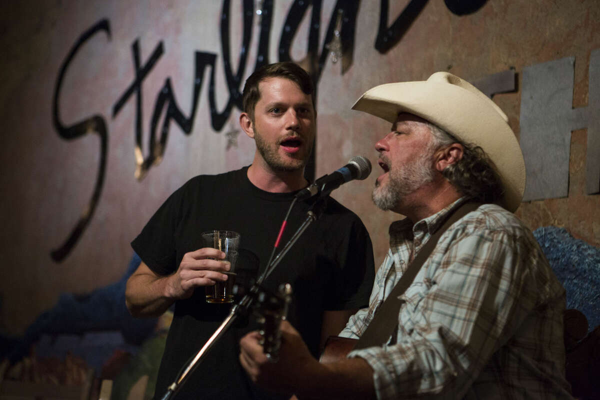Kyle Garmany, left, sings with Jeff Haislip at the Starlight Theatre in Terlingua, TX on April 20, 2015. Garmany was traveling through from Austin and joined in Haislip's performance for a song even though they had not previously met. Artists perform regularly at the Starlight Theatre and on the porch attached to it.