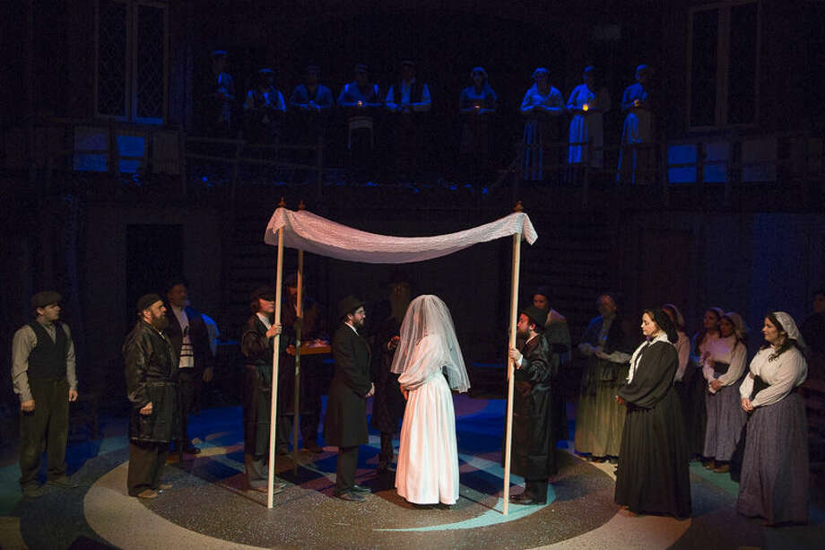 Billy Baker and Blake Rogers in a wedding scene flanked by John Preece and Micaela Grenier from 'Fiddler on the Roof' by Odessa College. Photo: Courtesy Photo