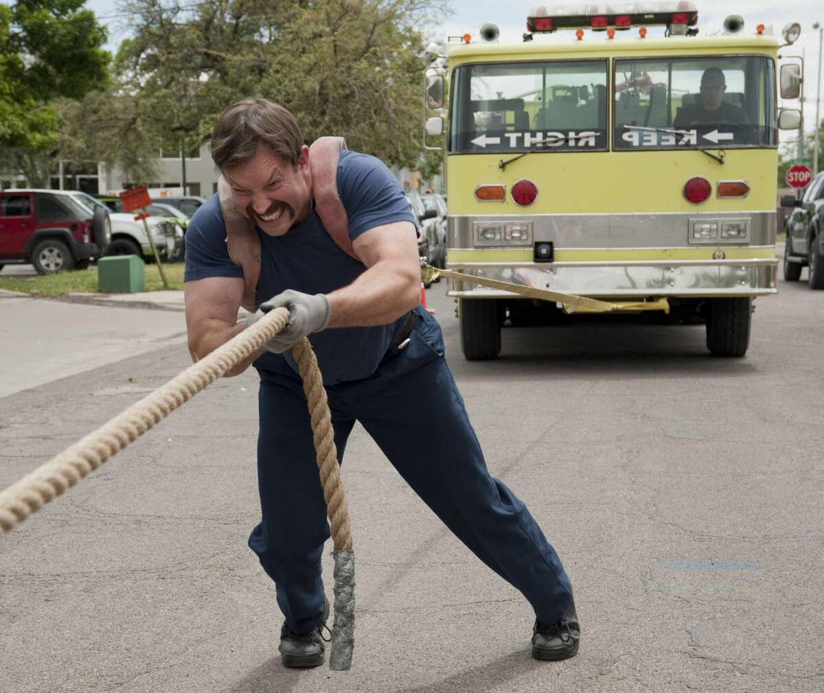 MFD's Russell Clarke strains to pull a 37,000 lbs fire truck Monday, 4-27-15, as they train for the upcoming Strong Man/Woman Competition to raise money for fellow firefighter Aaron Hughes family who recently lost his battle with cancer. Tim Fischer\Reporter-Telegram