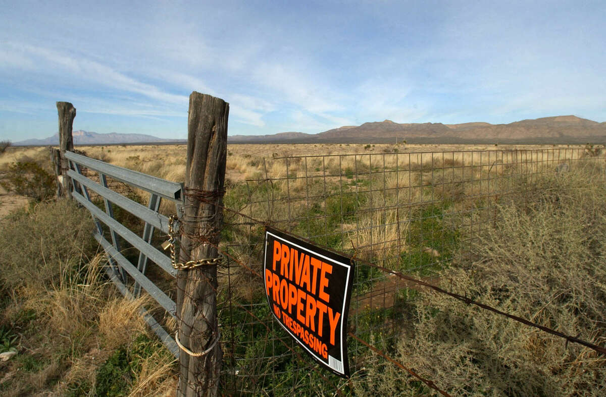 Private property signs mark the property owned by Amazon.com's Jeff Bezos, near Texas' highest peak, El Capitan, rear left, in Culberson County near Van Horn, Texas. (AP Photo/Tony Gutierrez)