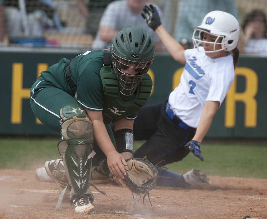 Midland College's Amy Anderson reaches for the ball but can not make the tag as Western Texas' Shambry Sanders slides in to score Friday afternoon in the first game of a double header. Tim Fischer\Reporter-Telegram Photo: Tim Fischer
