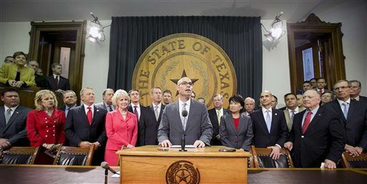 Rep. Dennis Bonnen, center, surrounded by other representatives, announces his plan for a sales tax cut at the Capitol in Austin, Texas, on Wednesday, April 8, 2015. (AP Photo/Austin American-Statesman, Jay Janner) AUSTIN CHRONICLE OUT; COMMUNITY IMPACT OUT; INTERNET MUST CREDIT PHOTOGRAPHER AND STATESMAN.COM