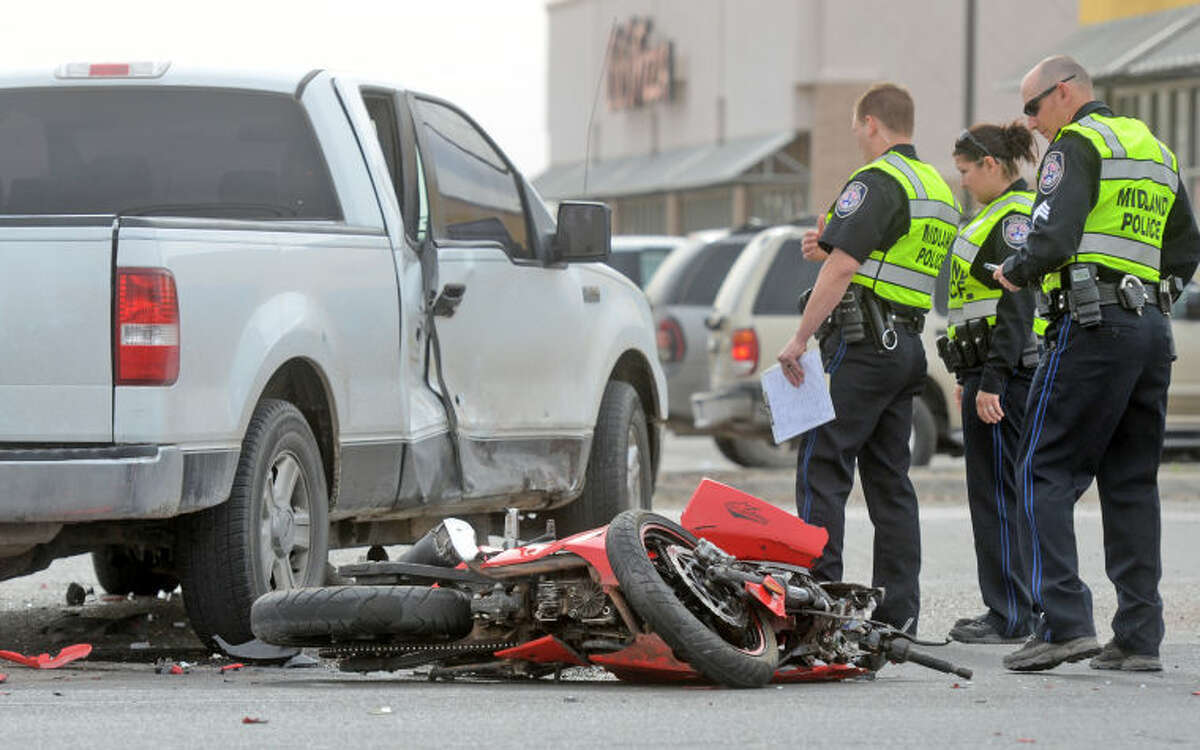 Midland emergency personnel investigate the scene of a crash involving a motorcycle Saturday on Ranken Highway near the location of the south Walmart. James Durbin/Reporter-Telegram
