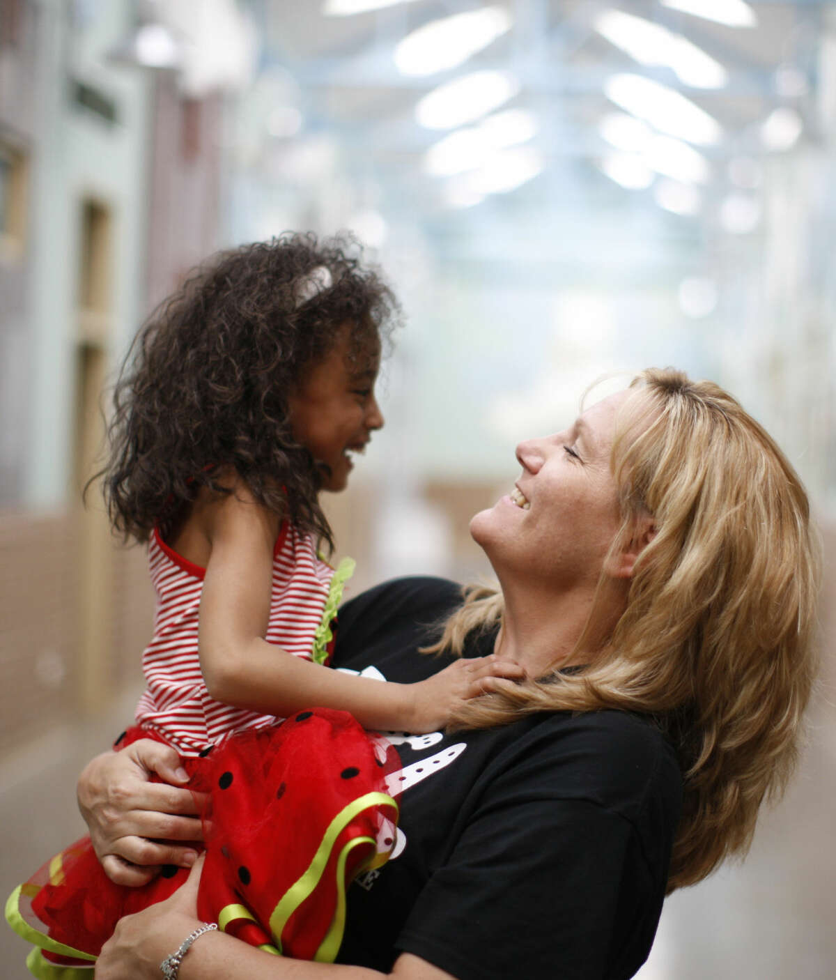Erin Davis poses for a photo with her 6-year-old daughter at Midland Children's Rehab on Tuesday, April 5, 2016. James Durbin/Reporter-Telegram