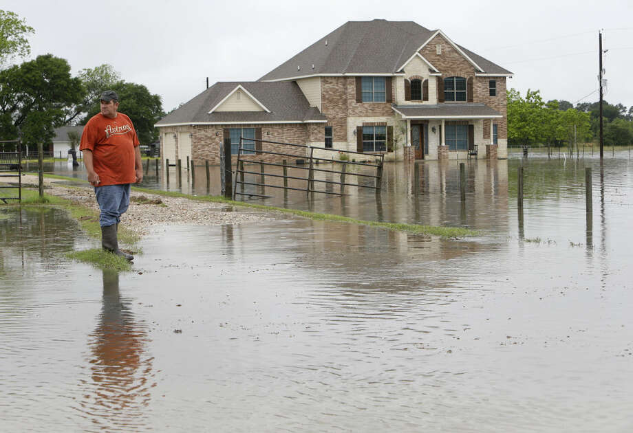 "Donald Treichel looks at the flood water along Cypress Rosehill Rd. in Cypress where the water is up to his doorstep shown Monday, April 18, 2016. He said, ""I've lived here 48 years and never seen it this high before."" ( Melissa Phillip / Houston Chronicle )"