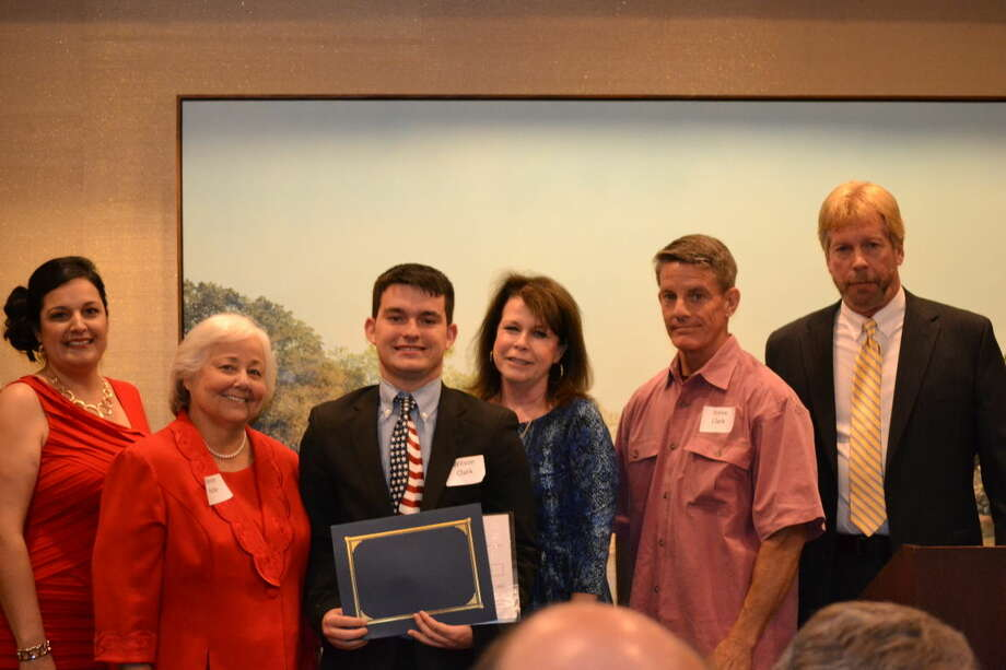 Lee High senior Wilson Clark, third from left, received the Honorable John G. Hyde Award. With Clark are Amanda Vuelvas, Midland Teen Court executive director; Sharon Hyde, the judge's widow; Laurie Clark and Steve Clark, Wilson's parents; and David Sutter, treasurer of the board of directors.