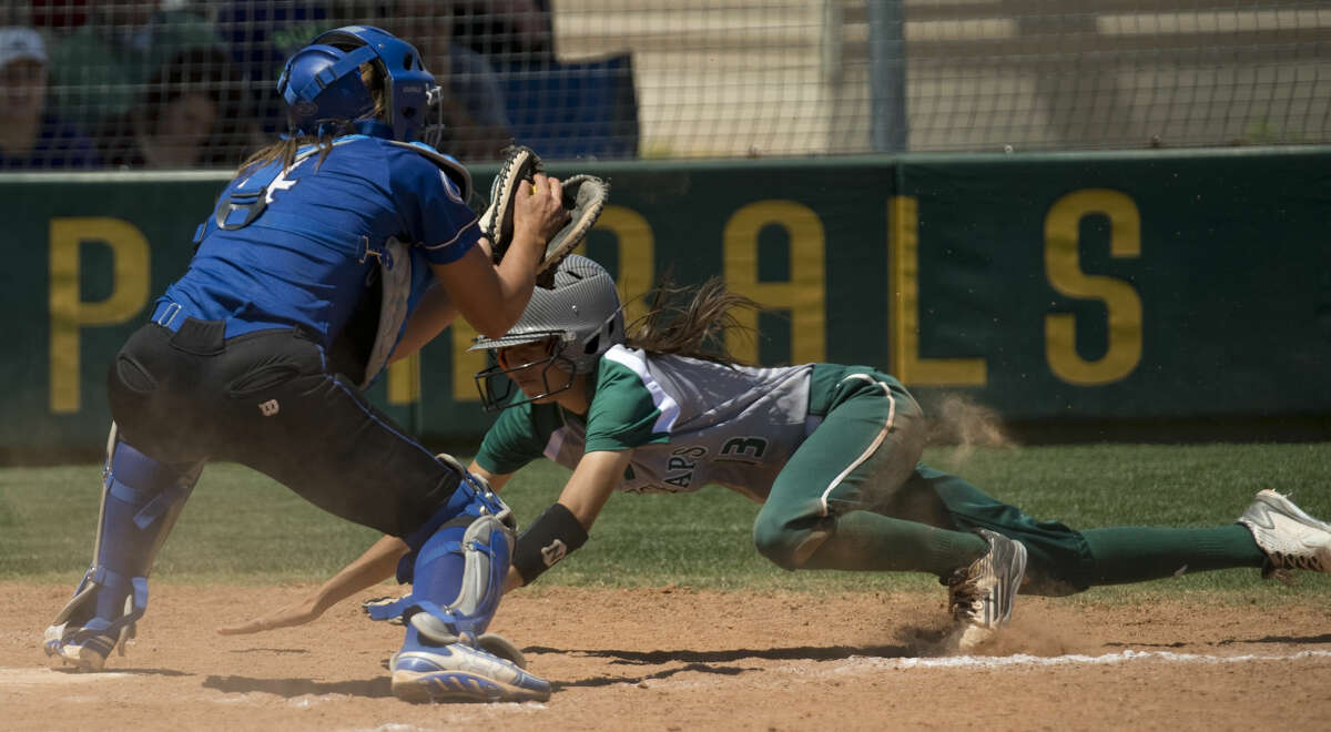 Odessa College's catcher, Mariah Jameyson, gets the ball and make the tag for an out as Midland College's Melina Martinez tries to score Friday 04-22-16 at MC. Tim Fischer\Reporter-Telegram