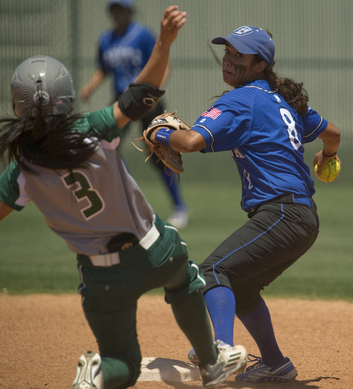 Odessa College's K'Leigh Arredondo makes the force out at second on Midland College's Jessica Bati and looks to throw to first for a double play Friday 04-22-16 at MC. Tim Fischer\Reporter-Telegram