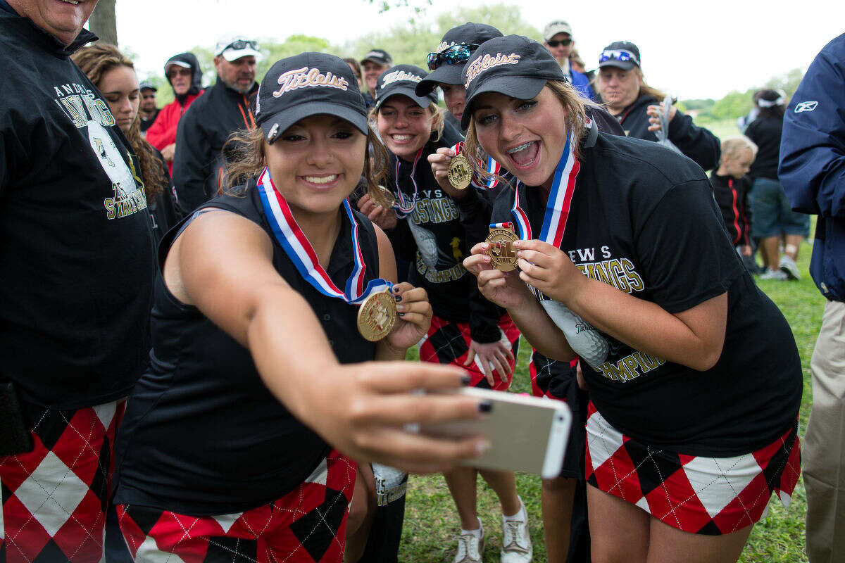 `The Andrews girls golf team Tuesday afternoon takes a selfie with their gold medals after winning the 4A UIL State Golf Championships at Onion Creek Club in Austin Texas.