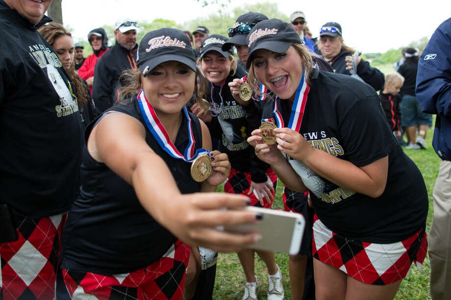 `The Andrews girls golf team Tuesday afternoon takes a selfie with their gold medals after winning the 4A UIL State Golf Championships at Onion Creek Club in Austin Texas. Photo: Courtney Sacco
