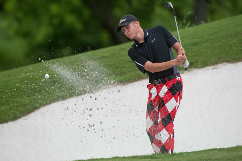 Andrews' Austin Lavato hits the ball out of the sand trap on the 18th hole during the second day of the 4A UIL State Golf Championships at Onion Creek Club in Austin Texas. Photo: Courtney Sacco