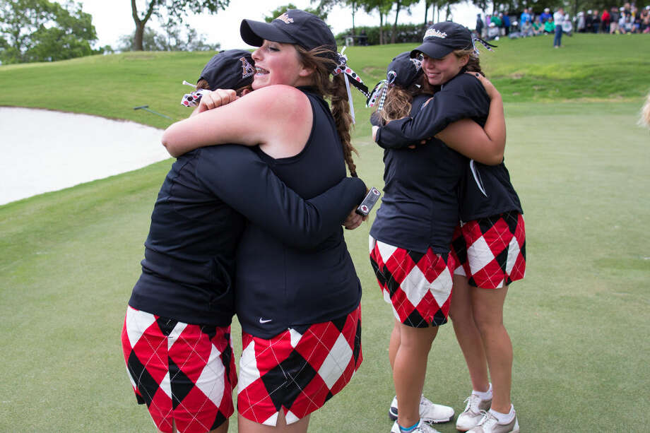 The Andrews girls golf team Tuesday celebrate on the 18th hole after their last player Hailey Burgen finished competing during 4A UIL State Golf Championships at Onion Creek Club in Austin Texas. Photo: Courtney Sacco
