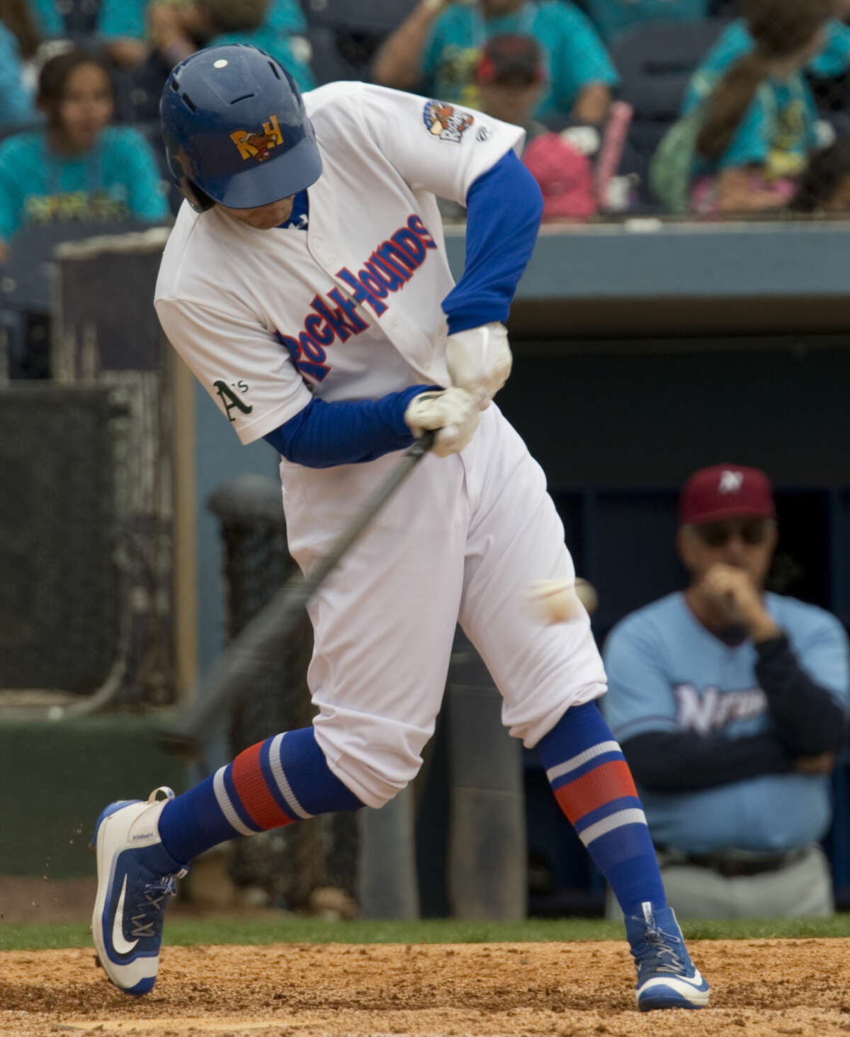 RockHounds' J.P. Sportman connects for a hit Tuesday 04-19-16 in a game against Northwest Arkansas at Security Bank Ballpark. Tim Fischer\Reporter-Telegram